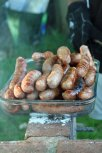 Sausages in a glass serving dish